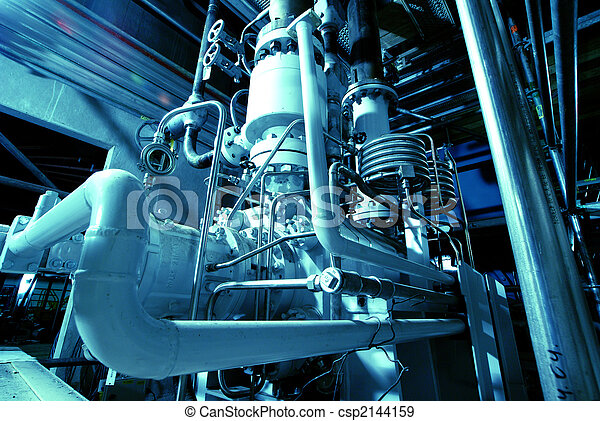 Pipes, tubes, machinery and steam turbine at a power plant - csp2144159