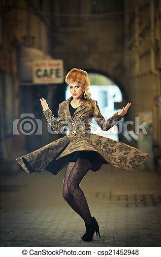 Elegant woman spinning around
