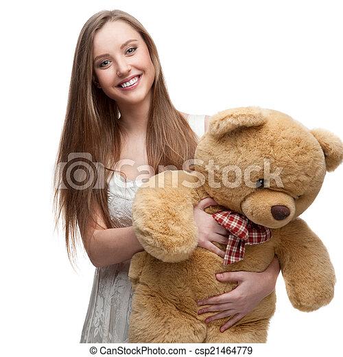 girl holding soft toy bear