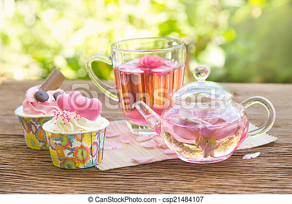 Afternoon tea breake, rose tea with tea pot in the garden