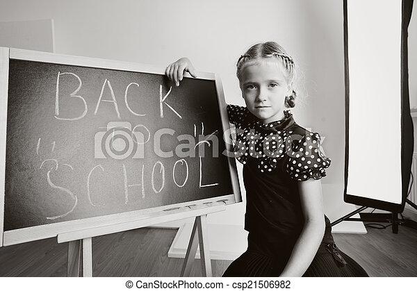 Smiling cute school girl drawing