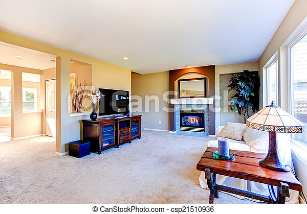 House interior with open floor plan. Living room with fireplace