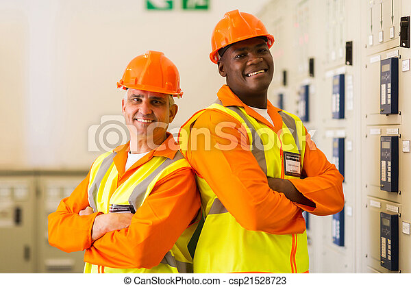 industrial engineers with arms crossed in power plant control ro - csp21528723