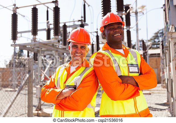 electrical engineers with arms crossed