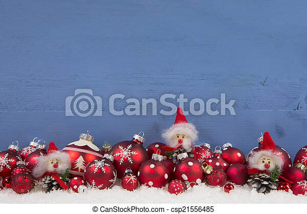 Wooden blue christmas background with red and white decoration.