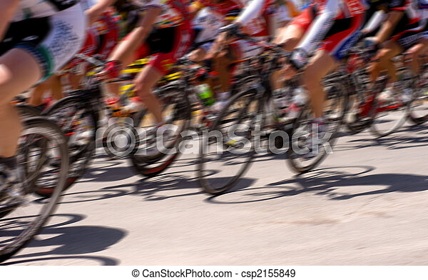 A bicycle race with motion blur, including copy space