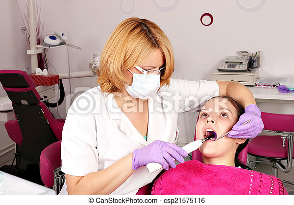 girl patient and dentist in dental office - csp21575116