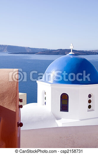 blue dome churches and classic cyclades architecture over the mediterranean sea in oia santorini the famous greek island - csp2158731