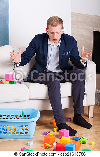Businessman gets upset at the mess in the house