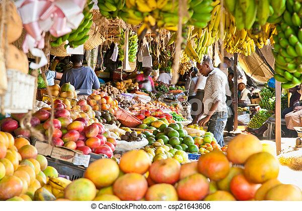 Ripe fruits stacked at a local market in Nairobi. - csp21643606