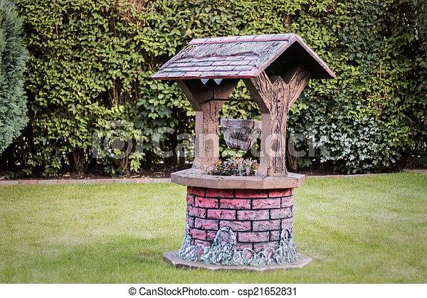 Photos de puits faux puits dans les jardin for Puits decoratif jardin