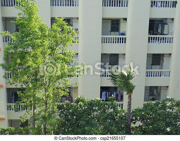 condominium with garden, urban trees