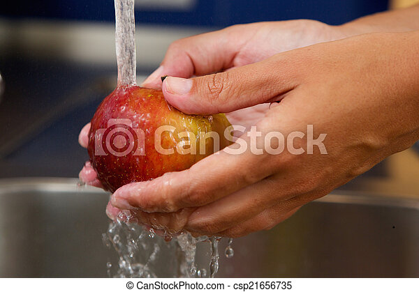 Female hands holding apple under water