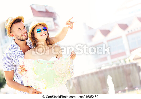 Romantic couple sightseeing with a map - csp21685450