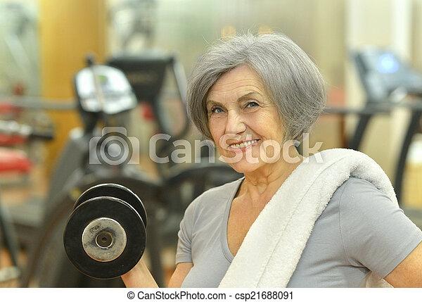 Senior woman exercising in gym - csp21688091