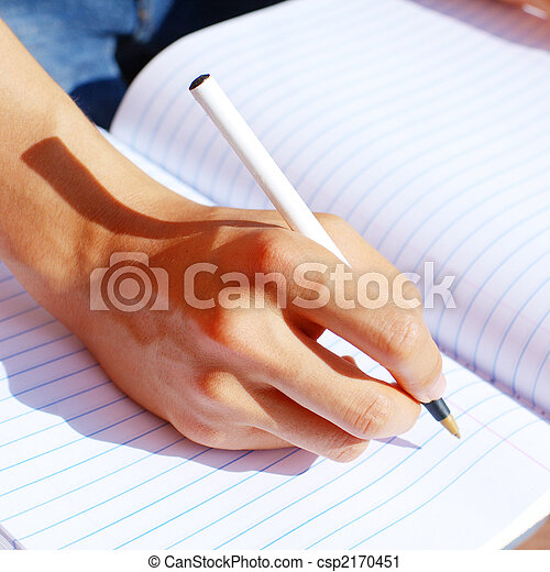 Girl Writing In Note Book - csp2170451