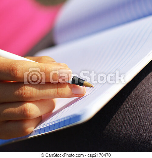 Girl Writing in Note Book - csp2170470