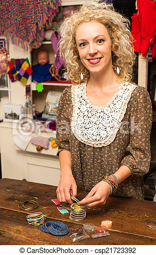 young woman making bracelet