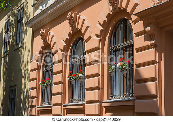 Stock Photo Of Ornate Wrought Iron Window Shutters With Germanium Plants Csp21740029 Search