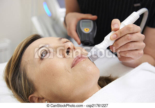 Beautician Carrying Out Ultrasound Skin Rejuvenation Treatment - csp21761227