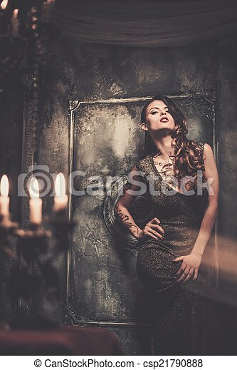 Tattooed beautiful woman in old spooky interior - csp21790888