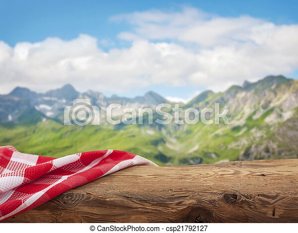 Empty wooden table with red napkin