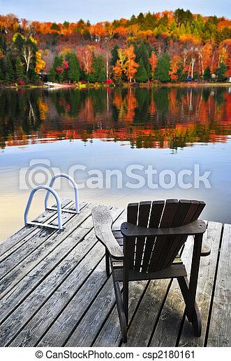 Wooden dock on autumn lake - csp2180161