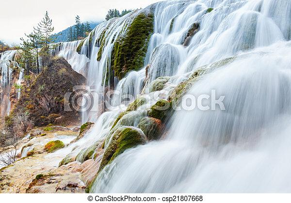 jiuzhaigou waterfall in autumn - csp21807668