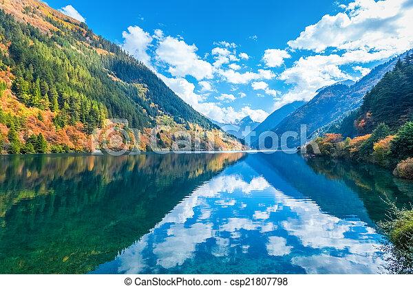 beautiful rhino lake in autumn jiuzhaigou  - csp21807798