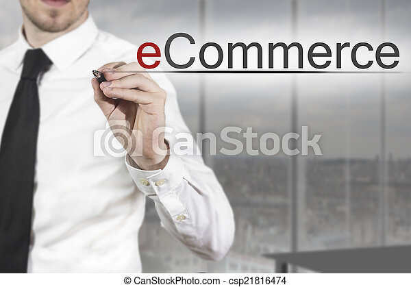 businessman writing ecommerce in the air - csp21816474