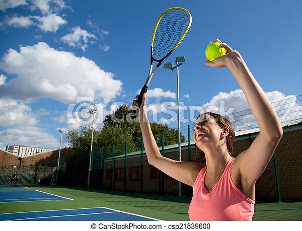 woman celebrating winning tennis match - csp21839600