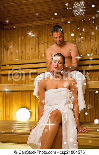 Composite image of man giving his girlfriend a neck massage in s