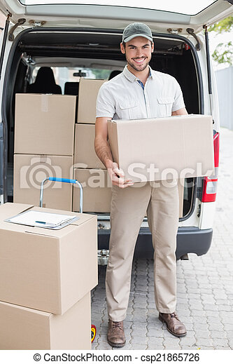 Delivery driver loading his van