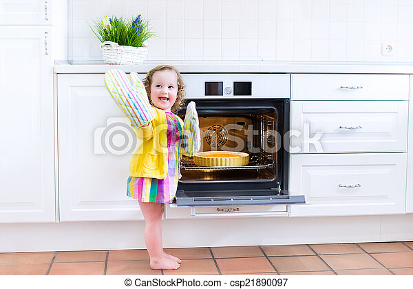 Toddler girl with an apple pie in the oven
