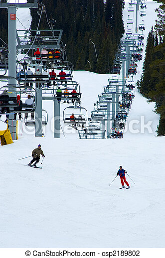 Busy snow ski resort with chairlift - csp2189802