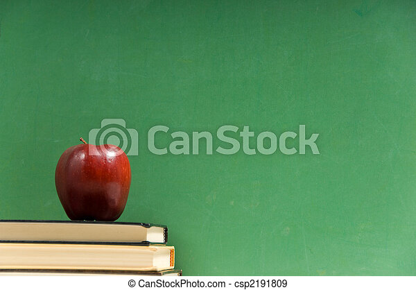 School books and chalkboard - csp2191809