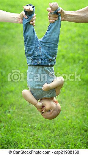 holding baby upside