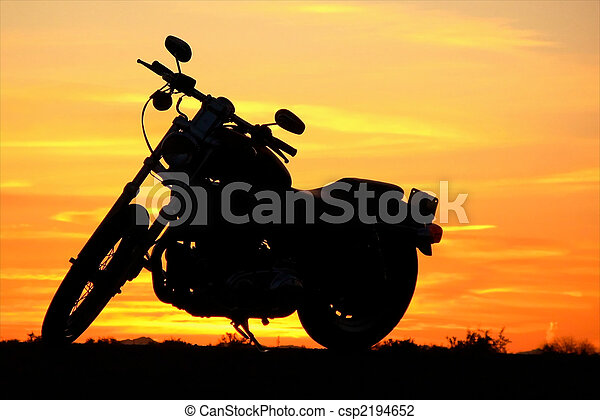 Motorcycle at sunset - csp2194652
