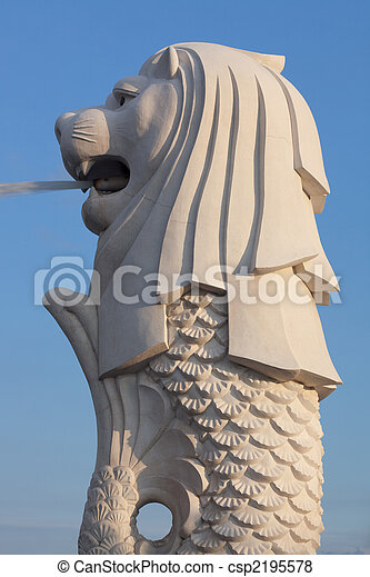 Profile view of the Singapore Merlion icon at Marina Bay in sunset - csp2195578
