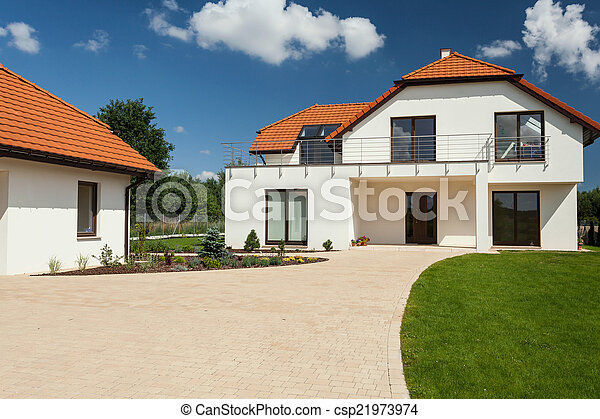 Picture of modern house with separate garage view of for Separate garage