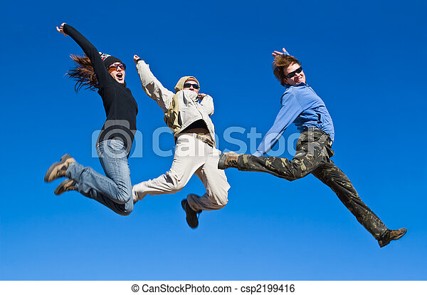 Group of hikers jumping cheerfully on mountain summit - csp2199416