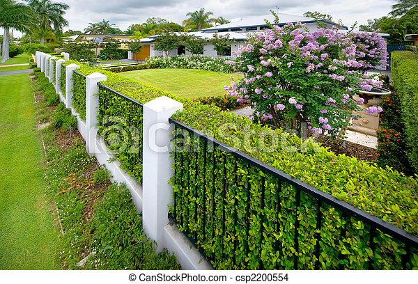 Stock Photo Of Fenceline To House Fenceline And Hedges