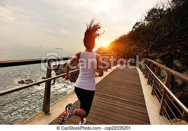 Runner athlete running on boardwalk