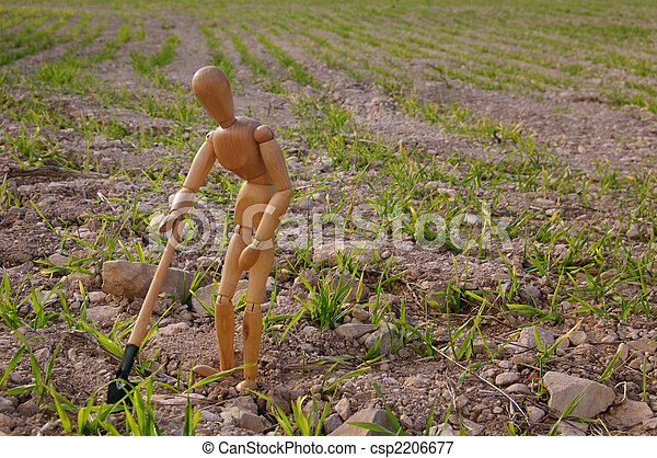peasant in a field with shovel - csp2206677