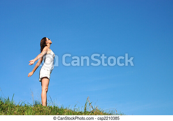 Woman feeling freedom surrounded by summer colors - csp2210385