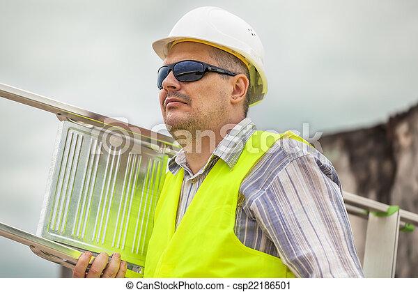 Worker with an aluminum ladder