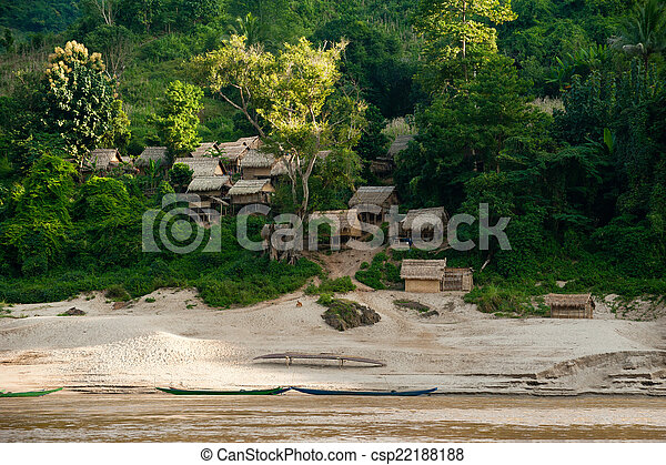Small asian village with traditional wooden house in jungles alo - csp22188188