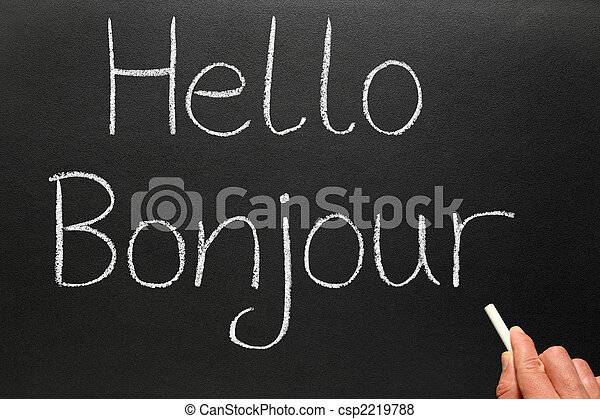 Bonjour, hello in French written on a blackboard. - csp2219788