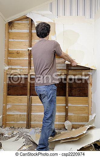 Man doing renovation work to house - csp2220974