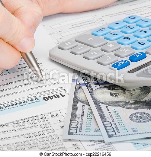 Stock images of male filling out 1040 us tax form with for 1040 tax table calculator